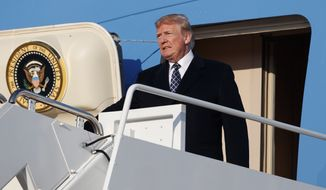 U.S. President Donald Trump arrives on Air Force One, Sunday, March 25, 2018, at Andrews Air Force Base, Md., en route to Washington as he returns from Palm Beach, Fla. (AP Photo/Carolyn Kaster)