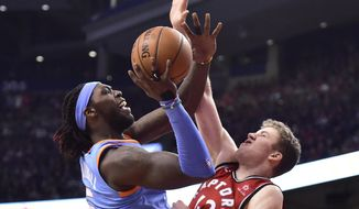 Los Angeles Clippers Montrezl Harrell shoots over Toronto Raptors centre Jakob Poeltl (42) during second half NBA basketball action in Toronto on Sunday, March 25, 2018. (Frank Gunn/The Canadian Press via AP)