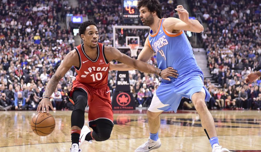 Toronto Raptors guard DeMar DeRozan (10) moves past Los Angeles Clippers guard Milos Teodosic (4) during first half NBA basketball action in Toronto on Sunday, March 25, 2018. (Frank Gunn/The Canadian Press via AP)