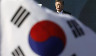 FILE - In this March 1, 2018 file photo, South Korean President Moon Jae-in delivers a speech during a ceremony celebrating the 99th anniversary of the March First Independence Movement against Japanese colonial rule, at Seodaemun Prison History Hall in Seoul, South Korea. Jae-in's visit to the United Arab Emirates this week shows the Asian nation's deepening cooperation with the Gulf country, from buying its oil, building the Arabian Peninsula's first nuclear power plant and potentially backing it in war. (Kim Hong-Ji/Pool Photo via AP, File)