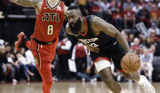 Houston Rockets guard James Harden, right, drives past Atlanta Hawks guard Damion Lee (8) during the first half of an NBA basketball game, Sunday, March 25, 2018, in Houston. (AP Photo/Eric Christian Smith)