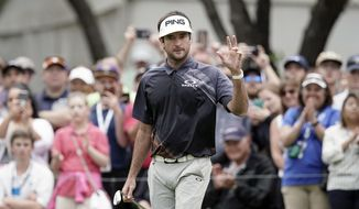 Bubba Watson waves to the gallery on the sixth hole during the final round at the Dell Technologies Match Play golf tournament, Sunday, March 25, 2018, in Austin, Texas. (AP Photo/Eric Gay)