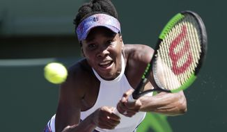 Venus Williams returns to Kiki Bertens, of the Netherlands, during the Miami Open tennis tournament, Sunday, March 25, 2018, in Key Biscayne, Fla. Williams won 5-7, 6-3, 7-5. (AP Photo/Lynne Sladky)