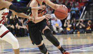 Oregon State's Kat Tudor, right, drives on Louisville's Asia Durr during the first half of an NCAA women's college basketball tournament regional final, Sunday, March 25, 2018, in Lexington, Ky. (AP Photo/James Crisp)