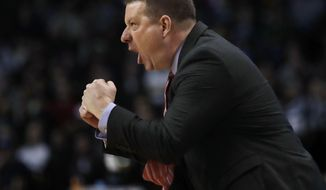 Texas Tech head coach Chris Beard shouts from the sideline during the first half of an NCAA men's college basketball tournament regional final against Villanova, Sunday, March 25, 2018, in Boston. (AP Photo/Charles Krupa)