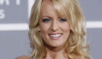 Stormy Daniels arrives for the 49th Annual Grammy Awards on Sunday, Feb. 11, 2007, in Los Angeles.  (AP Photo/Matt Sayles)