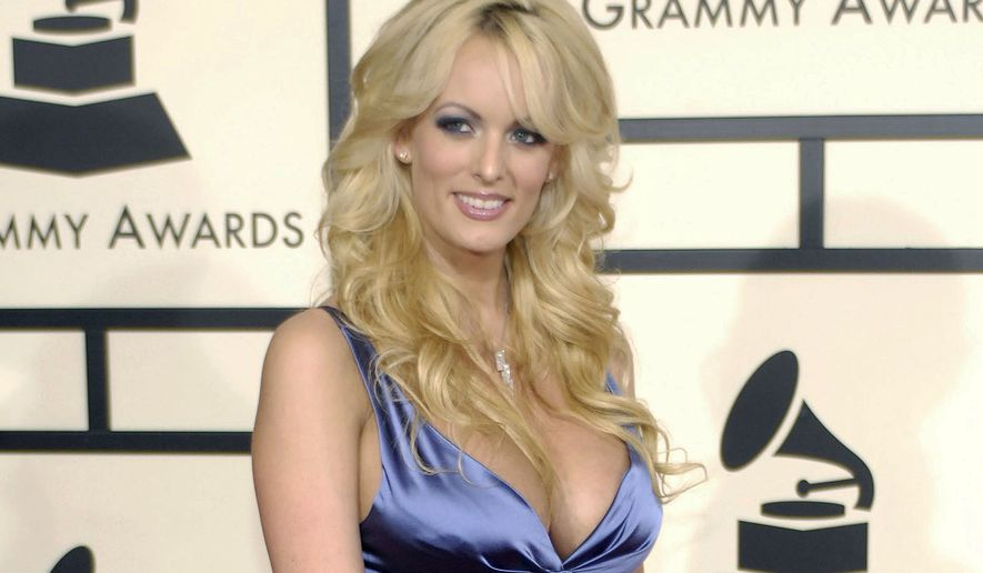 "FILE - In this Feb. 10, 2008 file photo, adult film star Stormy Daniels arrives at the 50th Annual Grammy Awards in Los Angeles. CBS News President David Rhodes says that a ""60 Minutes"" interview with Daniels needs more journalistic work. Rhodes' statement at a conference in Israel Tuesday was the first time CBS publicly confirmed it had interviewed Daniels, who has alleged an extramarital affair with Donald Trump before he became president. (AP Photo/Chris Pizzello, File)"