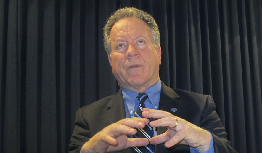 David Beasley, executive director of the World Food Program, talks during an interview at the Department of Foreign Affairs and Trade in Canberra, Australia, Monday, March 26, 2018. Beasley says the collapse of the Islamic State movements self-described caliphate across Syria and Iraq has led to extremists mounting a recruitment drive in sub-Sahara Africa which threatens to trigger a new European migrant crisis. (AP Photo/Rod McGuirk)