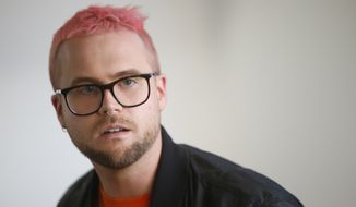 Whistleblower Christopher Wylie who alleges that the campaign for Britain to leave the EU cheated in the referendum in 2016, speaking at a lawyers office to the media in London, Monday, March 26, 2018. Chris Wylie's claims center around the official Vote Leave campaign and its links to a group called BeLeave, which it helped fund. The links allegedly allowed the campaign to bypass spending rules. (AP Photo/Alastair Grant)
