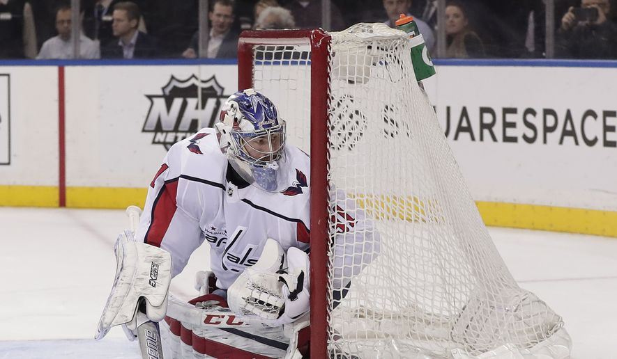 Washington Capitals goaltender Philipp Grubauer (31) defends the goal against the New York Rangers during the third period of an NHL hockey game, Monday, March 26, 2018, in New York. (AP Photo/Julie Jacobson)  **FILE**