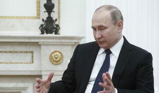 Russian President Vladimir Putin gestures as he speaks to Qatar Sheikh Tamim bin Hamad al-Thani during their meeting in the Kremlin in Moscow, Russia, Monday, March 26, 2018. (Sergei Karpukhin/Pool Photo via AP) ** FILE **