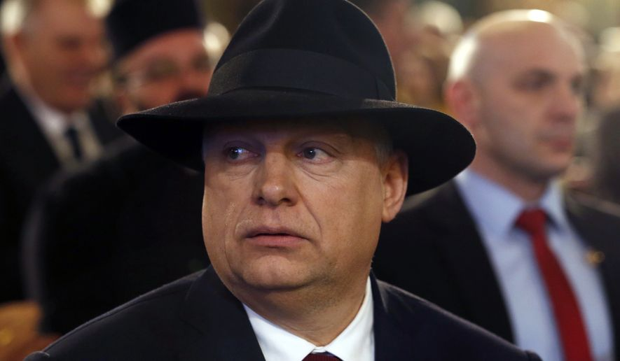 Hungary's Prime Minister Viktor Orban looks on during his visit to the ceremony marking the opening of a renovated synagogue in Subotica, Serbia, Monday, March 26, 2018. The renovation work on the synagogue, which was built in 1902, was financed jointly by both Serbia and Hungary in a sign of support for Serbia's depleted Jewish community. (AP Photo/Darko Vojinovic)