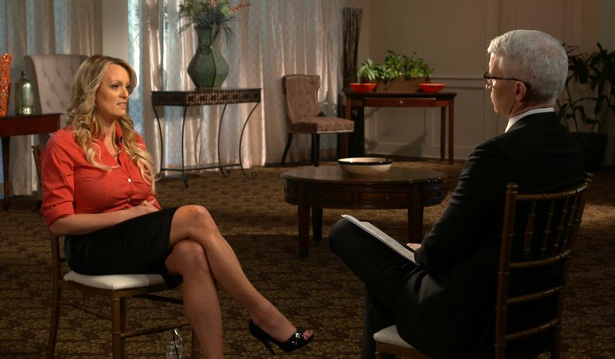 "This image released by CBS News shows Stormy Daniels, left, during an interview with Anderson Cooper which aired on Sunday, March 25, 2018, on ""60 Minutes."" (CBS News/60 Minutes via AP)"