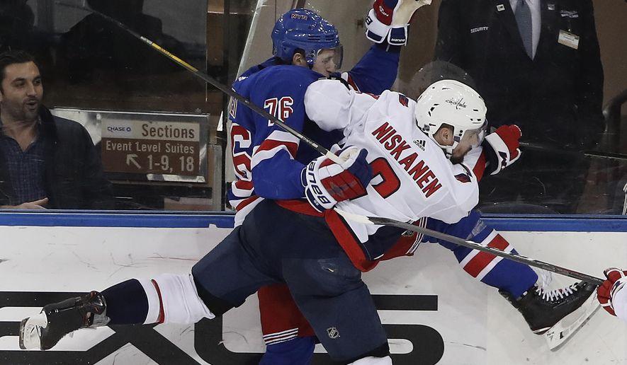 Washington Capitals defenseman Matt Niskanen (2) collides with New York Rangers defenseman Brady Skjei (76) during the third period of an NHL hockey game, Monday, March 26, 2018, in New York. (AP Photo/Julie Jacobson)