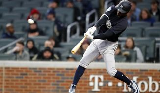 New York Yankees' Didi Gregorius (18) hits a two-run home run in the first inning of an exhibition baseball game against the Atlanta Braves, Monday, March 26, 2018, in Atlanta. (AP Photo/Todd Kirkland)