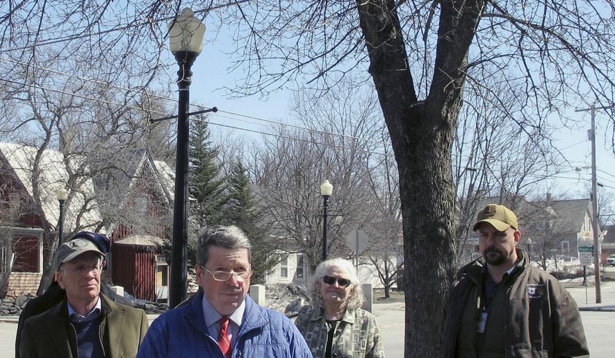 Vermont Agriculture Secretary Anson Tebbetts, center, discusses on Monday, March 26, 2018, in Randolph, Vt., the spread of the emerald ash borer, an invasive pest that kills ash trees, like the tree in the background. Tebbetts said Monday the emerald ash borer has been discovered in Barre, Groton and Plainfield. It was first detected in Orange. (AP Photo/Lisa Rathke)