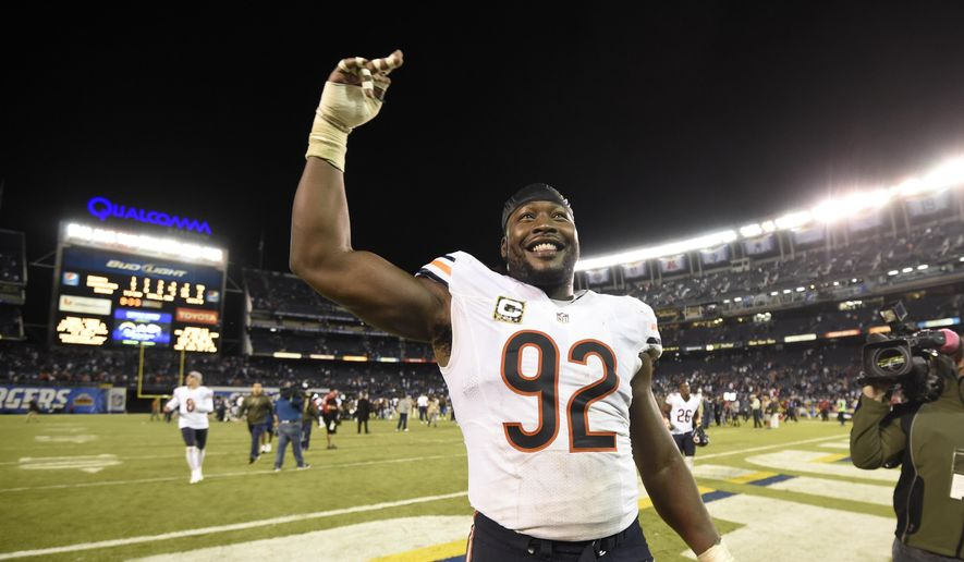 FILE - This Nov. 9, 2015 file photo shows Chicago Bears outside linebacker Pernell McPhee celebrating with fans after defeating the San Diego Chargers in an NFL football game in San Diego. The Washington Redskins have signed McPhee. The team announced the deal Monday, March 26, 2018. McPhee spent the past three seasons with the Chicago Bears. (AP Photo/Denis Poroy, file) **FILE**