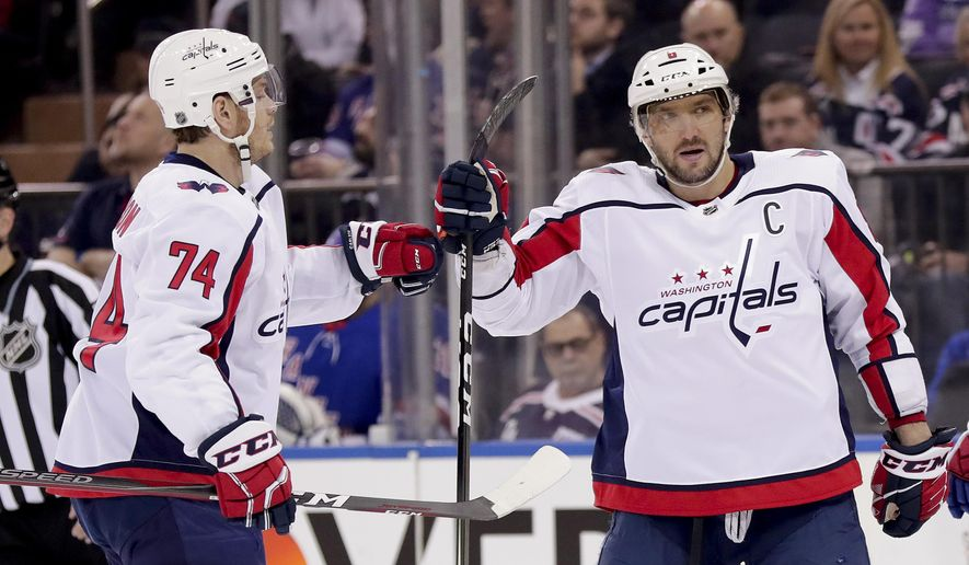 Washington Capitals left wing Alex Ovechkin (8) celebrates with defenseman John Carlson (74) after scoring a goal against the New York Rangers during the first period of an NHL hockey game, Monday, March 26, 2018, in New York. (AP Photo/Julie Jacobson)