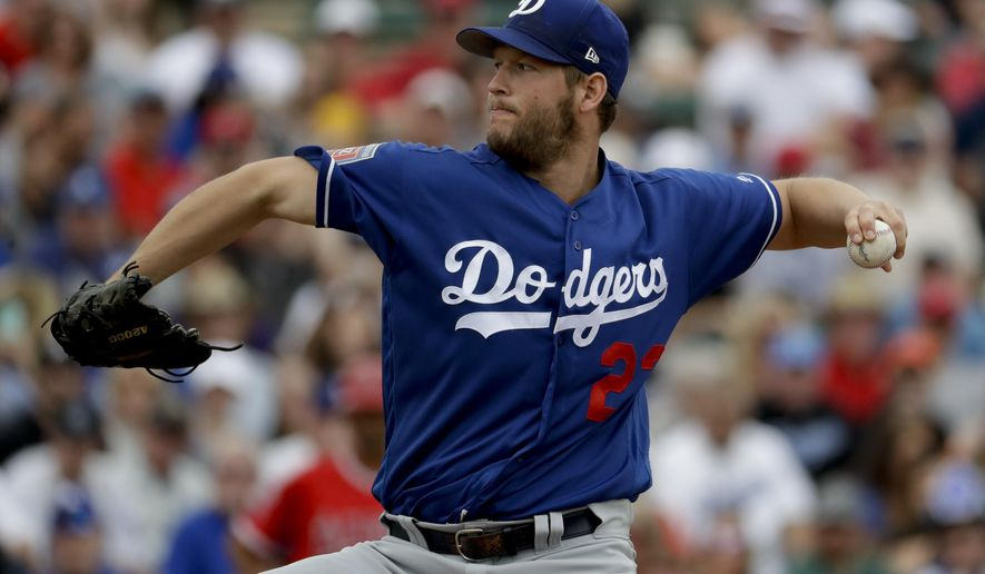 Los Angeles Dodgers starting pitcher Clayton Kershaw throws against the Los Angeles Angels during the first inning of a spring baseball game in Tempe, Ariz., Wednesday, March 7, 2018. (AP Photo/Chris Carlson)
