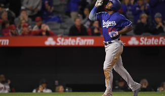 Los Angeles Dodgers' Yasiel Puig gestures after hitting a solo home run during the seventh inning of a spring training baseball game against the Los Angeles Angels Sunday, March 25, 2018, in Anaheim, Calif. (AP Photo/Mark J. Terrill)