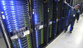 In this Oct. 15, 2013, file photo, Chuck Goolsbee, site director for Facebook's Prineville data centers, shows the computer servers that store users' photos and other data, at the Facebook site in Prineville, Ore. (Andy Tullis/The Bulletin via AP, File)