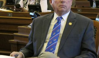 Kansas House Majority Leader Don Hineman, R-Dighton, watches one of the House's electronic tally boards as members approve a bill to narrow a law prohibiting state contractors from boycotting Israel, Monday, March 26, 2018, at the Statehouse in Topeka, Kan. The bill is designed to salvage the law after a federal judge blocked its enforcement (AP Photo/John Hanna)