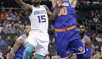 Charlotte Hornets' Kemba Walker (15) drives past New York Knicks' Enes Kanter (00) during the first half of an NBA basketball game in Charlotte, N.C., Monday, March 26, 2018. (AP Photo/Chuck Burton)