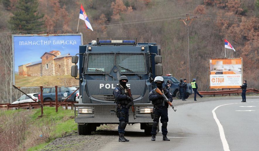 Kosovo police block a road near the northern, Serb-dominated part of Mitrovica, Kosovo, Monday, March 26, 2018. Serbian state television says Kosovo police have arrested one Serb official and fired tear gas and stun grenades at Serb protesters in northern Kosovo. (AP Photo/Bojan Slavkovic)