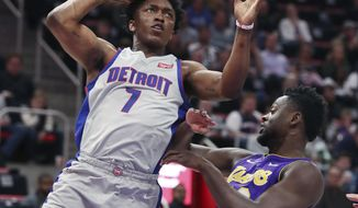 Detroit Pistons forward Stanley Johnson (7) shoots over Los Angeles Lakers forward Julius Randle during the first half of an NBA basketball game, Monday, March 26, 2018, in Detroit. (AP Photo/Carlos Osorio)