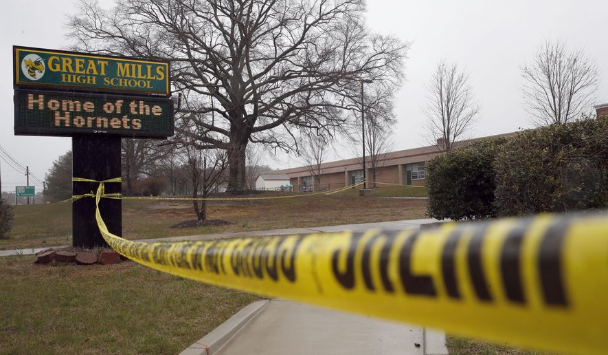 FILE - This Tuesday, March 20, 2018, file photo, shows crime scene tape around Great Mills High School, the scene of a shooting in Great Mills, Md. In a statement released Monday, March 26, 2018, authorities said the student who fatally shot a female classmate at the school died from a self-inflicted gunshot wound. (AP Photo/Alex Brandon, File)