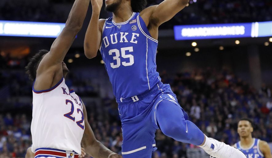 Duke's Marvin Bagley III (35) shoots over Kansas' Silvio De Sousa (22) during the first half of a regional final game in the NCAA men's college basketball tournament Sunday, March 25, 2018, in Omaha, Neb. (AP Photo/Charlie Neibergall)