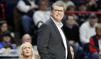 Connecticut head coach Geno Auriemma, front, reacts during the first half of a regional final against South Carolina at the a women's NCAA college basketball tournament Monday, March 26, 2018, in Albany, N.Y. (AP Photo/Frank Franklin II) **FILE**