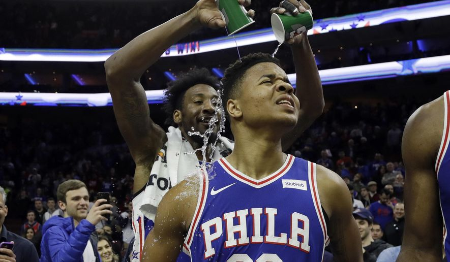 Philadelphia 76ers' Markelle Fultz, right, has water poured on him by Robert Covington after an NBA basketball game against the Denver Nuggets, Monday, March 26, 2018, in Philadelphia. Philadelphia won 123-104. (AP Photo/Matt Slocum)