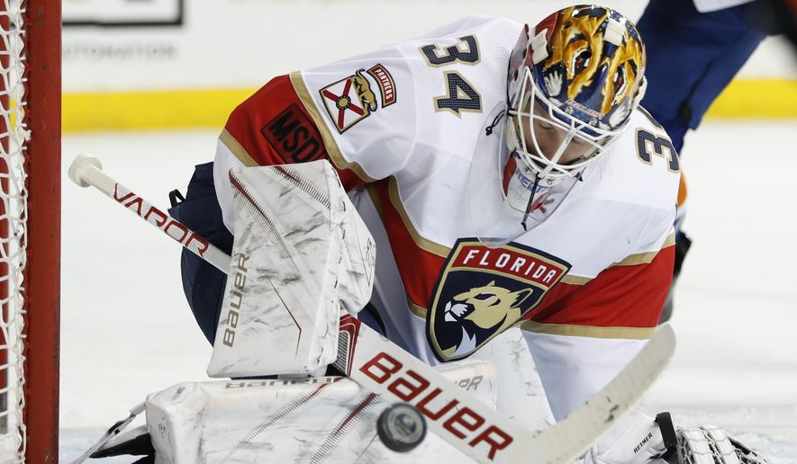 Florida Panthers goaltender James Reimer (34) makes a save during the second period of an NHL hockey game against the New York Islanders in New York, Monday, March 26, 2018. (AP Photo/Kathy Willens)