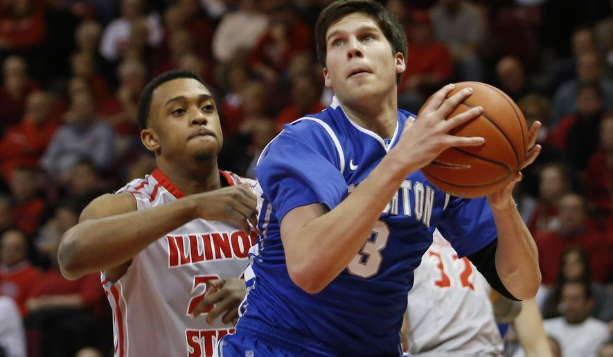 FILE - In this Jan. 2, 2013, file photo, Creighton's Doug McDermott (3) looks for room to shoot past Illinois State's Zeke Upshaw (24) during the first half of an NCAA college basketball game at Redbird Arena in Normal, Ill. Upshaw, the Detroit Pistons developmental player who collapsed on the court during a NBA G League game in Michigan has died. The Grand Rapids Drive says 26-year-old Upshaw died at a hospital Monday, March 26, 2018. No cause was disclosed. (AP Photo/ Stephen Haas, File)