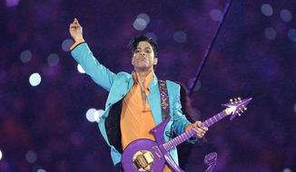 In this Feb. 4, 2007 file photo, Prince performs during the halftime show at the Super Bowl XLI football game at Dolphin Stadium in Miami. (AP Photo/Chris O'Meara, File)