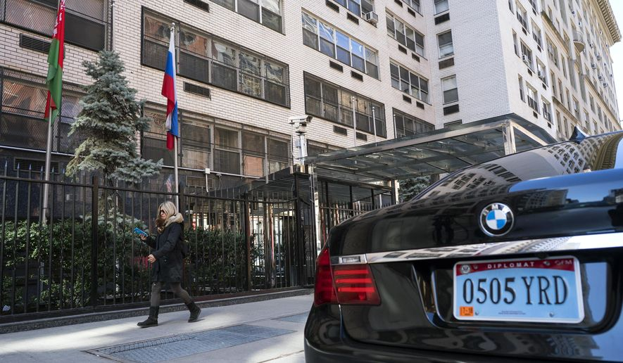 A woman walks past the Permanent Mission of the Russian Federation in New York Monday, March 26, 2018. The United States and more than a dozen European nations kicked out Russian diplomats on Monday and the Trump administration ordered Russia's consulate in Seattle to close, as the West sought joint punishment for Moscow's alleged role in poisoning an ex-spy in Britain.  (AP Photo/Craig Ruttle)