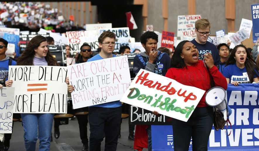 Attendees participate in the Las Vegas March for Our Lives event, which started at Symphony Park and ended in Las Vegas City Hall, on Saturday, March 24, 2018. (Andrea Cornejo/Las Vegas Review-Journal via AP)