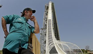 """In this July 9, 2014, file photo, ride designer Jeffery Henry looks over his creation, the world's tallest waterslide called """"Verruckt"""" at Schlitterbahn Waterpark in Kansas City, Kan. The Kansas City Star reports that Schlitterbahn Waterparks and Resorts co-owner Henry was arrested Monday, March 26, 2018, in Cameron County, Texas. (AP Photo/Charlie Riedel, File)"""