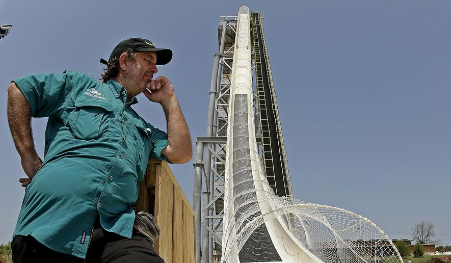 "In this July 9, 2014, file photo, ride designer Jeffery Henry looks over his creation, the world's tallest waterslide called ""Verruckt"" at Schlitterbahn Waterpark in Kansas City, Kan. The Kansas City Star reports that Schlitterbahn Waterparks and Resorts co-owner Henry was arrested Monday, March 26, 2018, in Cameron County, Texas. (AP Photo/Charlie Riedel, File)"