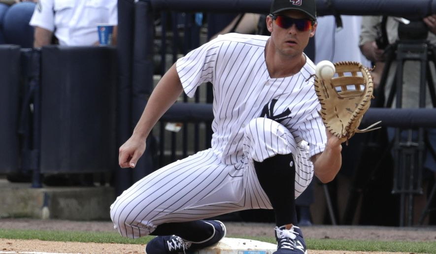 FILE - In this Feb. 23, 2018, file photo, New York Yankees first baseman Greg Bird fields the ball during a baseball spring exhibition game against the Detroit Tigers, in Tampa, Fla. Yankees manager Aaron Boone says it's too early to know if first baseman Greg Bird will be sidelined opening day Thursday at Toronto because of inflammation in his right foot.Boone said the team should learn Bird's status after he's evaluated Monday, March 26, 2018, by a specialist in New York. (AP Photo/Lynne Sladky, File)
