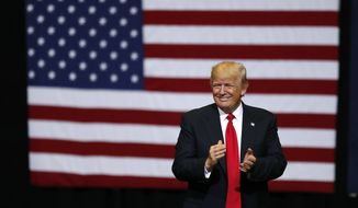 President Donald Trump smiles at supporters as he arrives to speak at a rally, Wednesday, June 21, 2017, in Cedar Rapids, Iowa. (AP Photo/Charlie Neibergall) ** FILE **