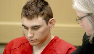 In this Feb. 19, 2018, file photo, Nikolas Cruz, accused of murdering 17 people in the Florida high school shooting, appears in court for a status hearing in Fort Lauderdale, Fla. Cruz was formally charged Wednesday, March 7, with 17 counts of first-degree murder, which could mean a death sentence if he is convicted. (Mike Stocker/South Florida Sun-Sentinel via AP, Pool, File)