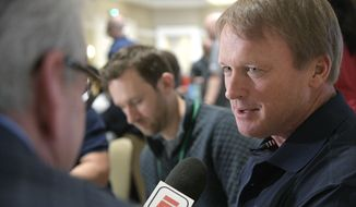 Oakland Raiders head football coach Jon Gruden, right, answers a question from a reporter at the coaches breakfast during the NFL owners meetings, Tuesday, March 27, 2018 in Orlando, Fla. (Phelan M. Ebenhack/AP Images for NFL)