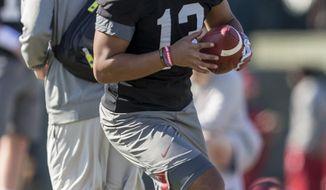 Alabama quarterback Tua Tagovailoa (13) works through drills with a thumb injury during the NCAA college football team's practice Thursday, March 22, 2018, in Tuscaloosa, Ala. (Vasha Hunt/AL.com via AP)