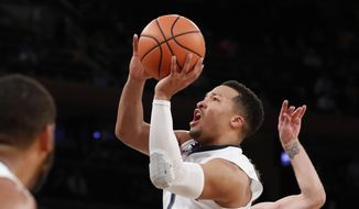 FILE - In this March 8, 2018, file photo, Villanova guard Jalen Brunson (1) goes up for a shot during the first half of an NCAA college basketball quarterfinal game in the Big East conference tournament, in New York. Brunson is a member of the Associated Press NCAA college basketball All-America first team, announced Tuesday, March 27, 2018. (AP Photo/Kathy Willens, File) **FILE**