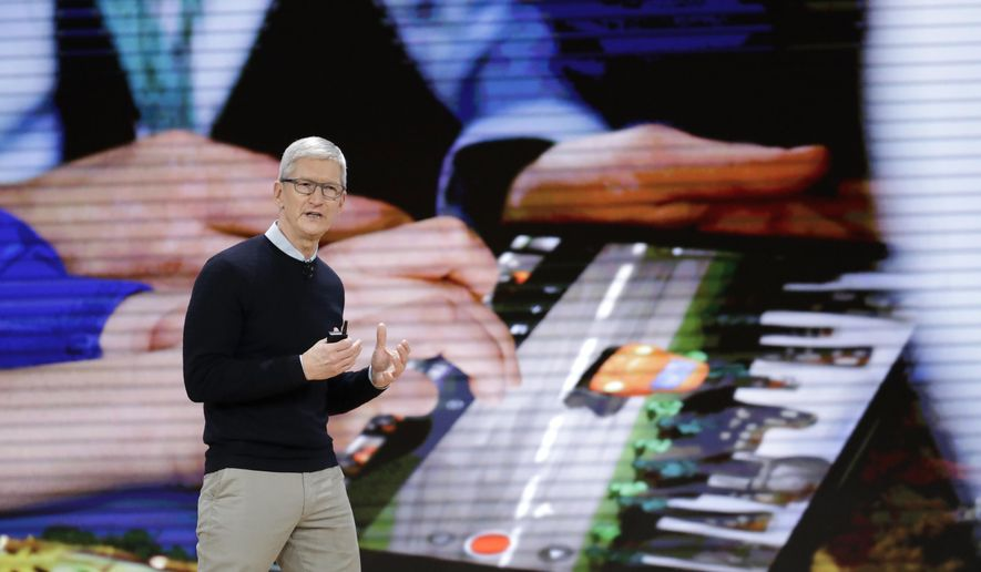 Apple CEO Tim Cook speaks during an Apple event at Lane Technical College Prep High School, Tuesday, March 27, 2018, in Chicago. (AP Photo/Charles Rex Arbogast)