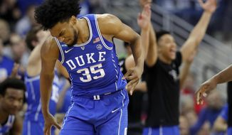 Duke's Marvin Bagley III (35) celebrates after making a 3-point basket during the second half of a regional final game against Kansas in the NCAA men's college basketball tournament Sunday, March 25, 2018, in Omaha, Neb. (AP Photo/Charlie Neibergall)