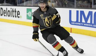 Vegas Golden Knights center William Karlsson celebrates after scoring in an empty net during the third period of an NHL hockey game against the Colorado Avalanche, Monday, March 26, 2018, in Las Vegas. Vegas won 4-1. (AP Photo/John Locher)