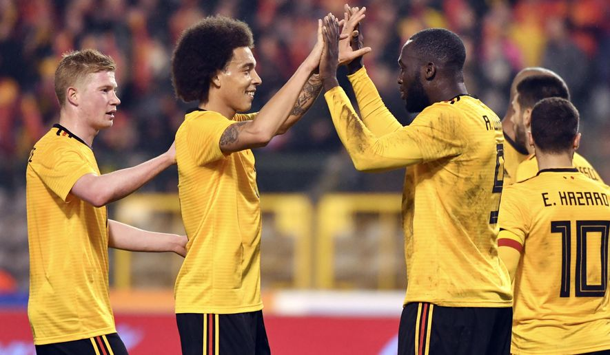 Belgium's Romelu Lukaku, center right, is congratulated by Belgium's Axel Witsel, center left, after scoring his sides second goal during an international friendly soccer match between Belgium and Saudi Arabia at King Baudouin stadium in Brussels on Tuesday, March 27, 2018. (AP Photo/Geert Vanden Wijngaert)